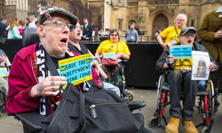 Disability rights campaigners protest in Westminster