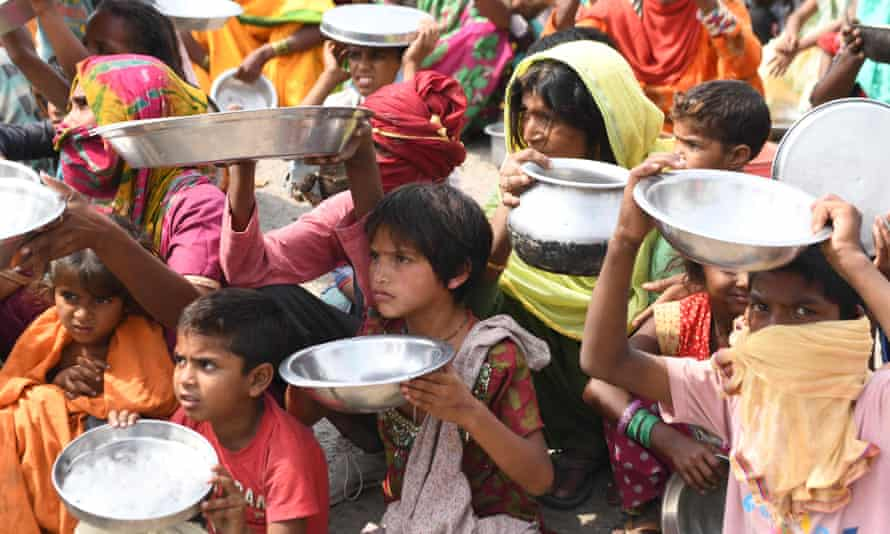 Migrant labourers and their family members from Maharastra protest against food shortages after the government eased a nationwide Covid-19 lockdown, 31 May, 2020.