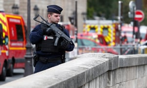 French police and security forces establish a security perimeter near the Paris police HQ where four staff were killed