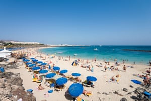 The crowded main beach at Playa Blanca on Lanzarote before the Covid-19 outbreak.