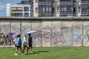 Visitors walk alongside the Berlin Wall memorial, on Bernauer street