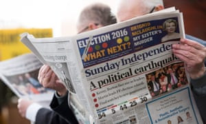 A man reads the Sunday Independent newspaper in Dublin on 28 February 2016