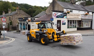 Sandbags being delivered outside shops in Whaley Bridge high street