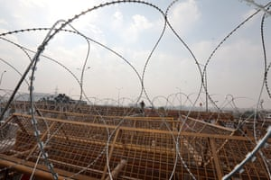 A general view of barbed wire and barricades placed by security personnel as farmers protest at the Delhi Ghazipur border.