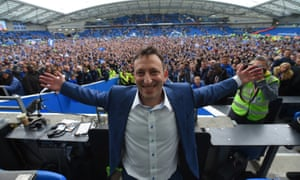 Tony Bloom celebrates at the end of Brighton & Hove Albion's 2-1 victory over Wigan Athletic on Monday. A result which ultimately sealed their promotion to the Premier League