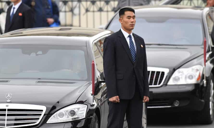 A security guard stands by a Mercedes Maybach limousine used by Kim Jong-un in Vladivostok.