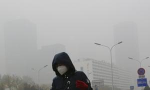 A woman wearing a mask in Beijing