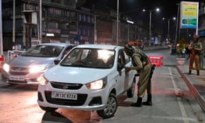 Indian paramilitary trooper stops car