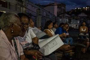Members of the Mariana Crioula squat initiative examine documents