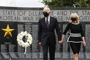 Joe Biden and Jill Biden depart after placing a wreath at the Delaware Memorial Bridge Veterans Memorial Park.