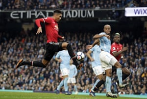 Chris Smalling volleys in the third.