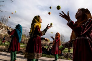 Kabul, 2016: A group of Afghan girls juggle tennis balls in the streets of the capital.