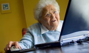 An older woman using her laptop computer at home