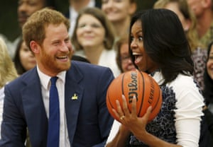 Prince Harry hands US first lady Michelle Obama the basketball