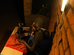 Eliani Patison's daughter also works as a seamstress during the evenings, with the help of a solar-powered lamp