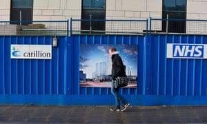 A pedestrian walks past Carillion's Royal Liverpool University Hospital construction site