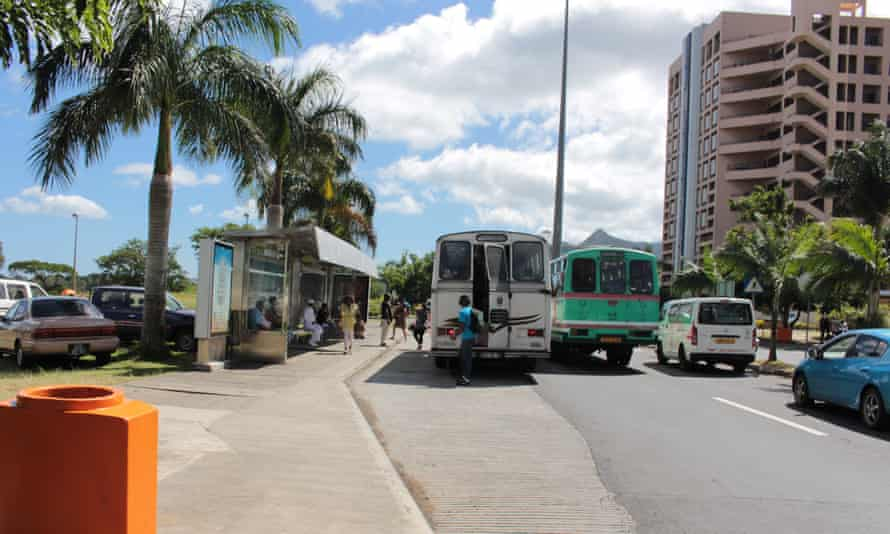 The modern office buildings are serviced by an outdated public transportation system. Cybercity in Ebène, Mauritius