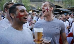England fans drink beer in London