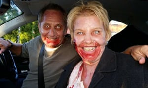 Two people made up as zombies