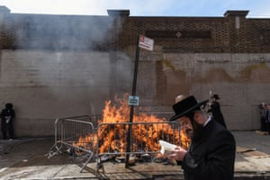 Worshippers participate in the Jewish ceremony  Srifes Chumetz before the start of the Passover.