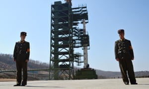 North Korean soldiers guard a Unha-3 rocket at at the Sohae Satellite Launch Station