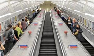 Passengers travelling on escalators at an underground station