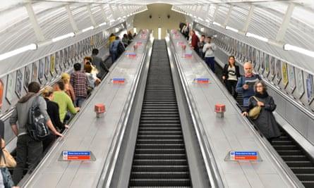 Passengers on an escalator
