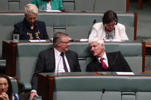 Anthony Albanese talks to Bob Katter on the crossbenches during question time in December 2018.