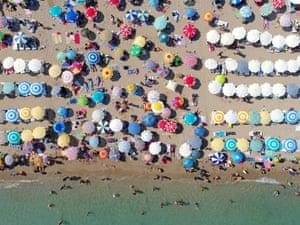 Aydin, Turkey: People sunbathe at Altinkum beach on a hot summer's day