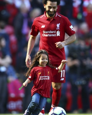 Liverpool's Mohamed Salah watches his daughter Makka steal the limelight at Anfield.