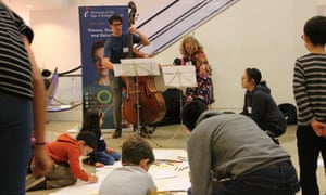 Drawing with OAE musicians Joanna Lawrence and John-Henry Baker at the Guardian cartoon and art family day.