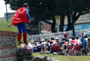 Superman uses his power of flight to get a better view of the peloton as it passes on stage 13, between Muret and Rodez