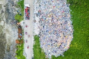 Truck and motorbikes pass through dumpsite at northern end of Fongafale island