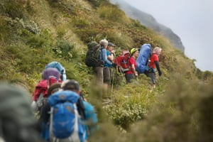 Kelly guides walkers as they climb towards Mackinnon Pass.