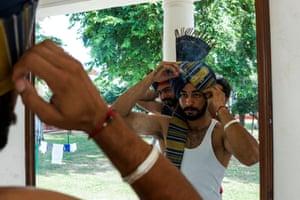 A soldier adjusts his headgear