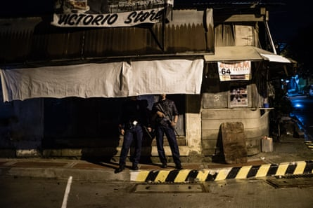 A police officer on a routine patrol in Manila. It is claimed that some police are secretly involved in extra-judicial killings.