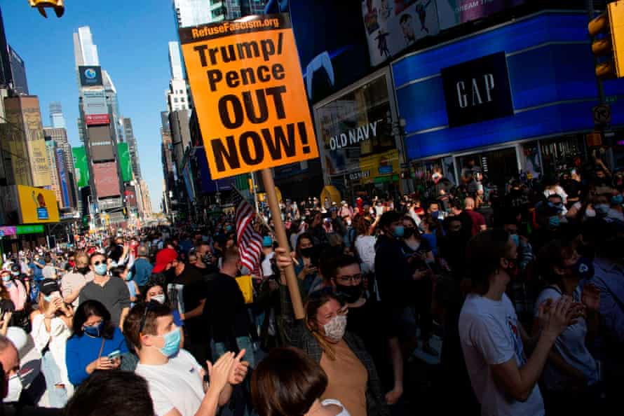 People celebrate at Times Square in New York after Joe Biden was declared winner of the 2020 presidential election on November 7, 2020.
