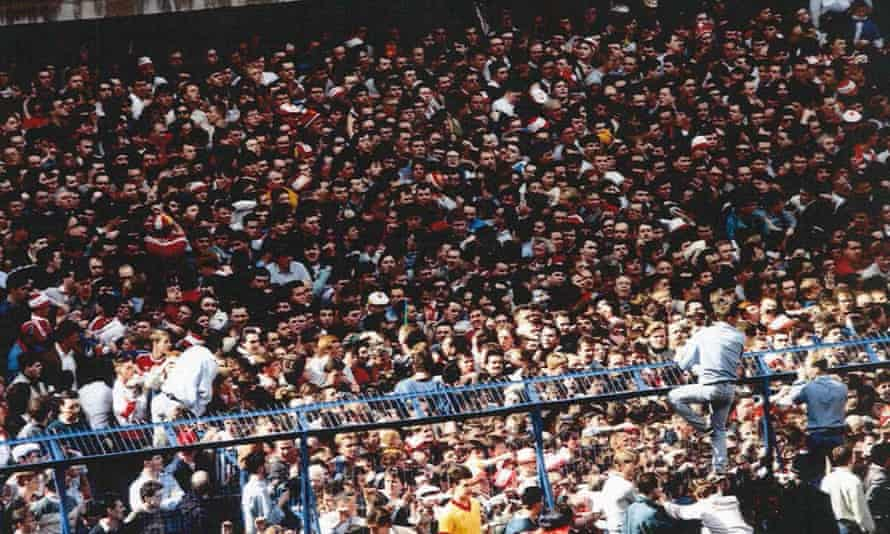 Fans try to get to safety at Hillsborough during the 1989 semi-final.