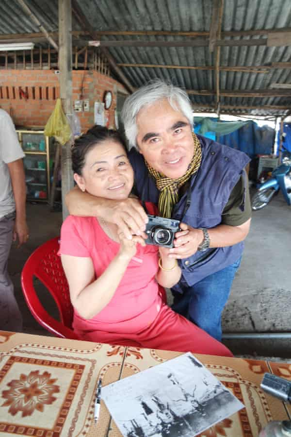 Ho Thi Hien in her cafe at Trang Bang, 25 miles north-west of Saigon, with AP photographer Nick Ut.