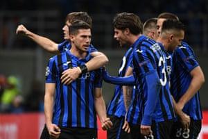Atalanta's Swiss midfielder Remo Freuler celebrates with team mates.
