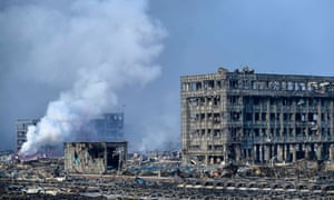 Buildings are destroyed by the deadly explosions in Binhai New Area in Tianjin. Fifty people were confirmed dead and hundreds of firefighters are still battling the blaze.