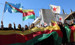 Protesters hold flags of the Democratic Union party (PYD) in a demonstration against exclusion of Syrian Kurds from the Geneva peace talks.