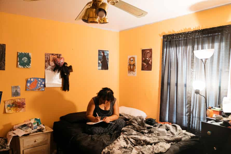 Tiffany Pennywell writes a poem in her bedroom in Shreveport. 'There was a lot of crying on my part because I was torn,' she said about her decision to have an abortion.