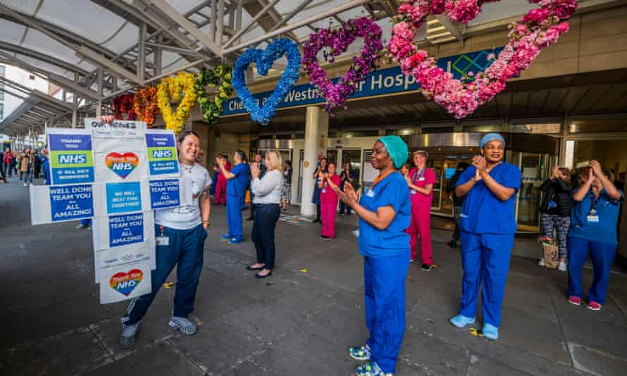Chelsea and Westminster hospital staff and members of the public applaud the NHS.