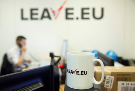 "A worker answers a telephone in the office of Brexit group pressure group ""Leave.eu"" in London"