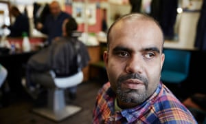 Banaris Iqbal at Hussain's barber shop in Keighley