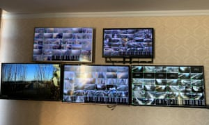 Video screens inside the the China Shengmu Organic Dairy in Inner Mongolia.