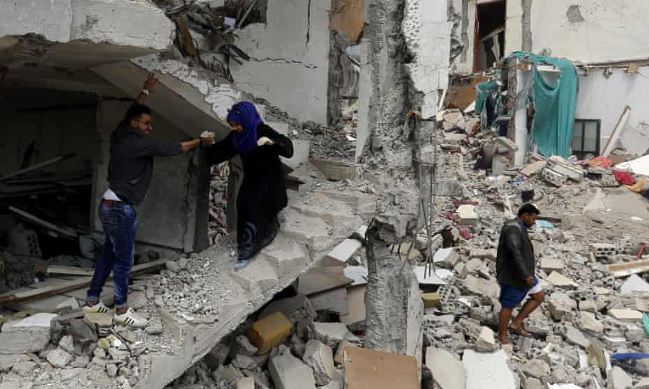 Yemenis inspect the debris of a housing block allegedly destroyed by a Saudi-led military coalition airstrike in Sana'a