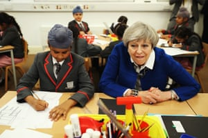 Theresa May meets pupils at Nishkam primary school in Birmingham on Tuesday