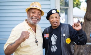 """Emory Douglas, left, the party's former minister of culture, and Ishan Bobino, a Panther """"cub"""", or child of the party."""